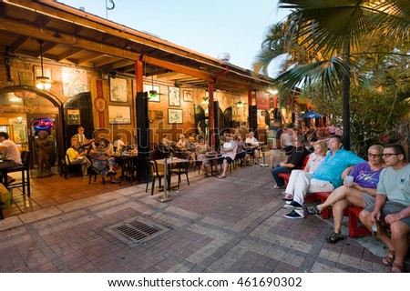 KEY WEST, FLORIDA, USA - MAY 03, 2016: Tourists are eating and relaxing at a restaurant near Mallory Square in Key West in Florida.