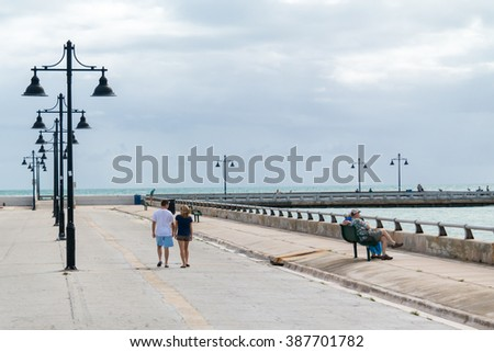 KEY WEST, USA - DEC 13, 2015: People on White Street Fishing Pier in Key West, Florida Keys