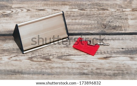 key with blank tag and metal nameplate - stock photo
