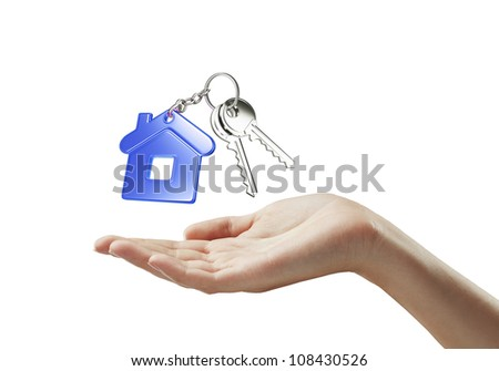key with  blue key chain in hand on white background - stock photo