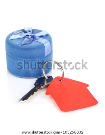 Key with house-shaped charm and box isolated on white