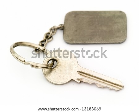 Key with trinket on a white background