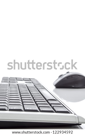 Keyboard and mouse isolated over white background. - stock photo