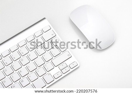 Keyboard and mouse on a white background, close-up - stock photo