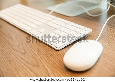 keyboard and mouse on woodden table : work place