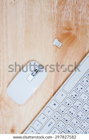 Keyboard and mouse on wooden table