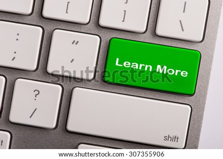 keyboard button with word learn more - stock photo