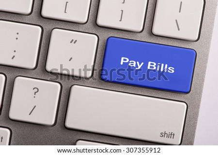 keyboard button with word pay bills