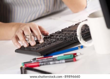 keyboard calculator, female officer using desktop keyboard calculate accounting. - stock photo