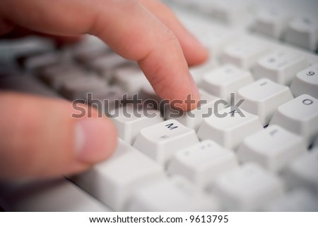 keyboard closeup with hand - stock photo