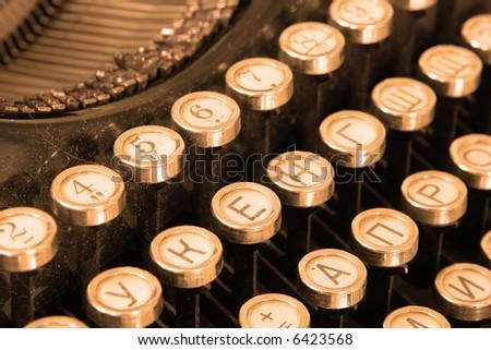 Keyboard of vintage typewriter close-up toned in sepia - stock photo