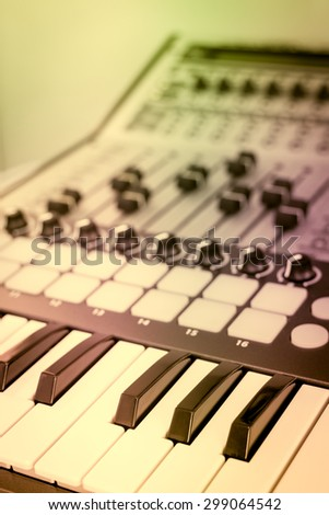 keyboard, piano, synthesizer & digital mixer in home studio + art filter for music background - stock photo