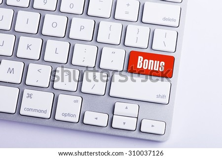 Keyboard with Bonus Button - stock photo