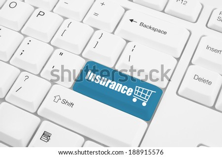 Keyboard with insurance button - stock photo