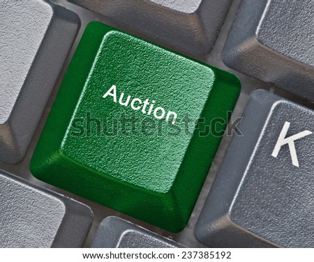 Keyboard with key for auction - stock photo