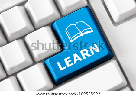 Keyboard with Learn text and book symbol - stock photo