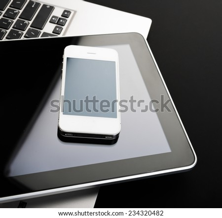 keyboard with phone and tablet pc on black background - stock photo