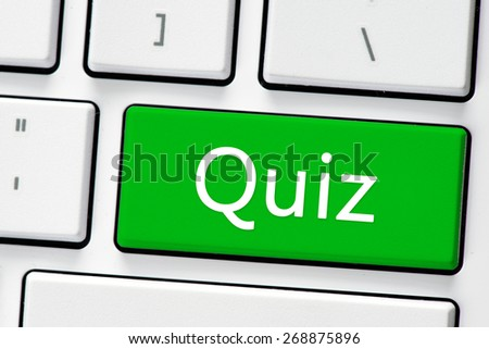 Keyboard with quiz button. Computer white keyboard with quiz button - stock photo