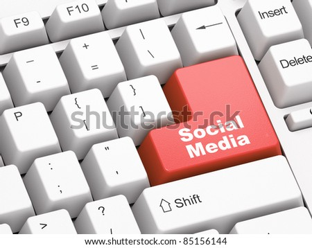 Keyboard with red Social Media button - stock photo