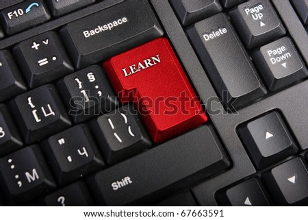 Keyboard with selective focus on the enter button saying LEARN - stock photo