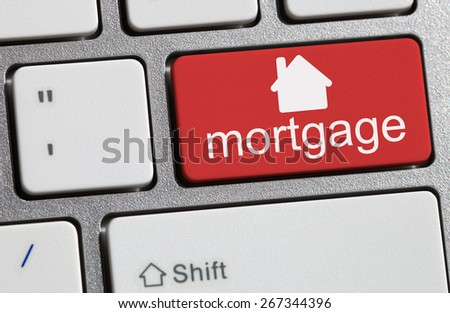 Keyboard with single red button showing the word mortgage - stock photo