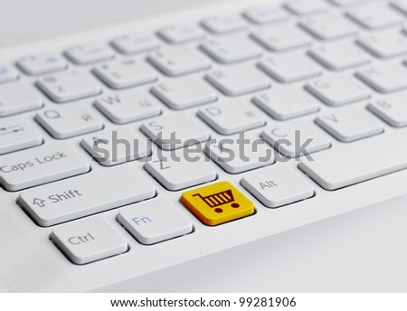 keyboard with yellow  shopping button - stock photo