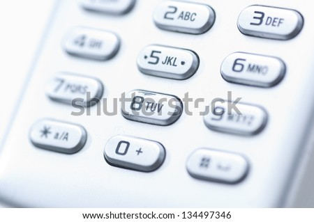 Keypad Keypad detail of an old fashioned used cellphone. - stock photo