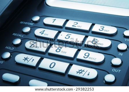 Keypad of a modern office telephone - stock photo