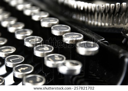 Keys and details of the mechanism of an old typewriter.