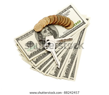 keys and stack of dollars isolated on a white background