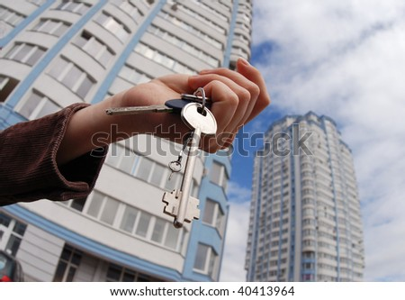 Keys being handed over the house - stock photo