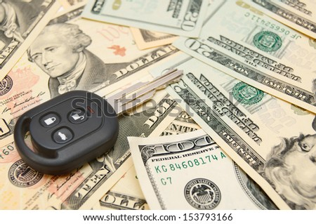 Keys from car on banknotes. - stock photo