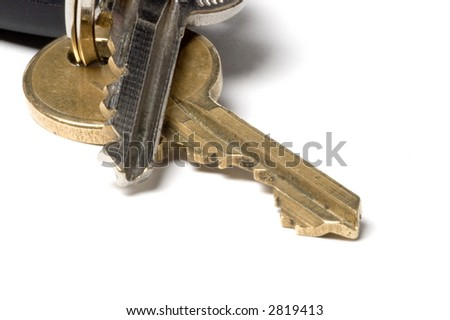 Keys in extreme closeup on a white background. Symbolizing entry,freedom,security and property - stock photo