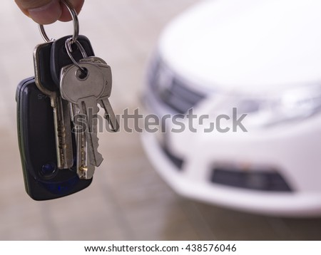 Keys in hand over the Car image
