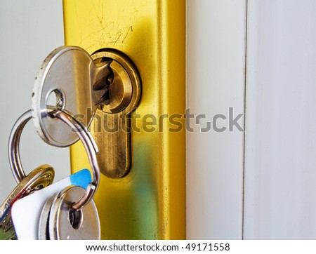 keys in the lock of a modern door mortgage concept - stock photo