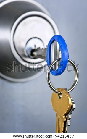 Keys inserted in door lock close up - stock photo