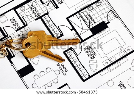 Keys on a floorplan concepts of real estate ownership - stock photo