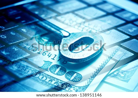 Keys on a one hundred dollar banknote and computer keyboard in b - stock photo