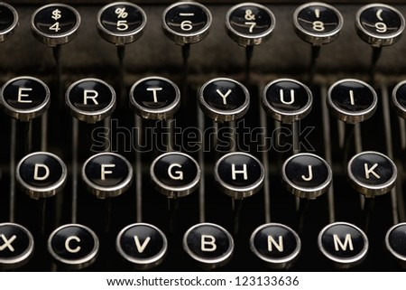 Keys on an antique typewriter. Straight shot of keys on an old typewriter including number row. - stock photo
