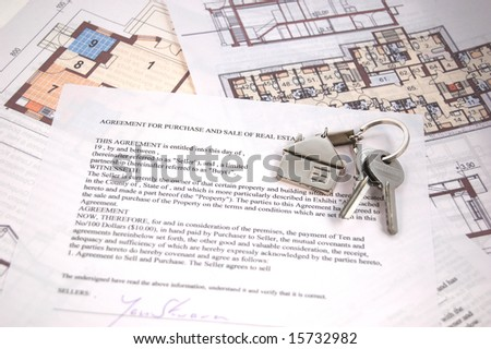 Keys on mortgage note and blueprints - stock photo