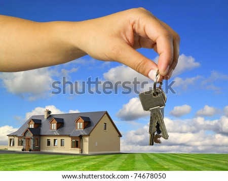 Keys to new idyllic house - stock photo