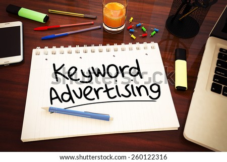 Keyword Advertising - handwritten text in a notebook on a desk - 3d render illustration. - stock photo