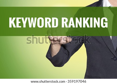 Keyword Ranking word Business man touch on vintage yellow green tab virtual screen - stock photo