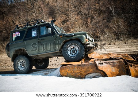 KHABAROVSK, RUSSIA - April  4, 2014: the SUV UAZ moving on off road