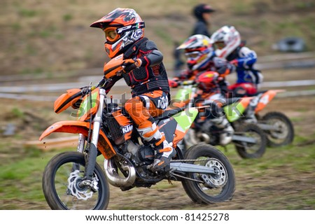 """KHABAROVSK RUSSIAN - MAY 21: 7 - Martin Clap, 5 - Artem Chernetsov, 4 - Mark Orlov in action at the first stage of the Khabarovsk enduro """"KHABARIGENS 2011 May 21, 2011 in Khabarovsk, Russia - stock photo"""