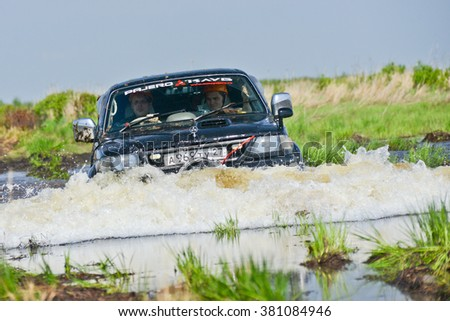 "Khabarovsk, Russian - May 25, 2013 : the Mitsubishi Pajero Sport moves quickly along a small river at competitions ""Tank storm 2013"""