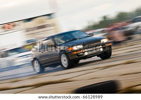 """KHABAROVSK RUSSIAN - SEPTEMBER 10: Dubov Maxim in action at Round 5 competition """"DRAG RACING in Khabarovsk"""".  on September 10, 2010 in Khabarovsk Russia - stock photo"""