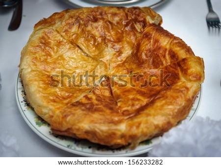 Khachapuri: Georgian bread dish filled with cheese. - stock photo