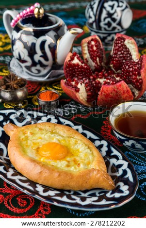 khachapuri, Georgian cake in the shape of the boat pastry with cottage cheese and egg suluguni - stock photo
