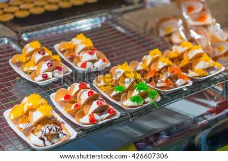 Khanom Beaung Thai or a kind of filled pancake Thai food or Thai Style Crisp Tart on tray,thai pancake delicious snacks, Thailand. - stock photo